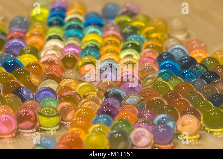 Bright wet balls of gidrogel as background, close-up photo - Stock Photo