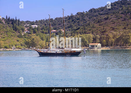 Ithaca -  Greece July 13 -  Big wooden sailboat anchored in a bay on the island of Ithaca off the northeast coast - Stock Photo