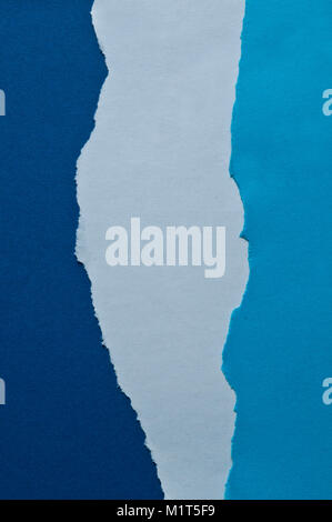 blue abstract background of ripped paper in different gradation of colour Stock Photo