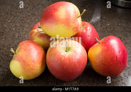 Selection of shop-bought Kansi apples variety Nicoter characterised by coloour, taste and crispness - Stock Photo