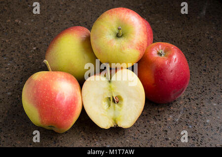 Selection of shop-bought Kansi apples variety Nicoter characterised by coloour, taste and crispness with one sliced - Stock Photo