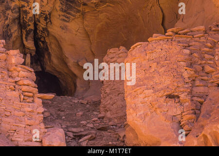 Ruins of a group of masonry structures made by the Ancestral Puebloan people some 700 years ago within Salt Creek - Stock Photo