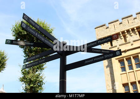 London, United Kingdom - August 26 2017: A sign post in the grounds of the Tower of London, depicting directions - Stock Photo