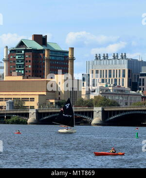 Boston, Massachusetts - August 16, 2017. MIT Sailing boat on Charles River in Boston, Massachusetts with Longfellow - Stock Photo