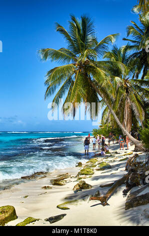 JOHNNY CAY, COLOMBIA - JANUARY 09, 2015: Some people walking on the beach in the coast of Johnny Cay island. - Stock Photo