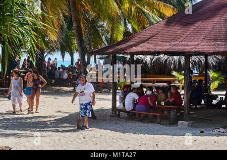 JOHNNY CAY, COLOMBIA - JANUARY 09, 2015: People having lunch and enjoying the day in Johnny Cay island. - Stock Photo