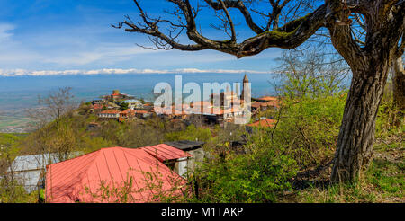 city of Signakhi in the mountains of Georgia, red tile roofs of brick houses against the background of the Alazani - Stock Photo