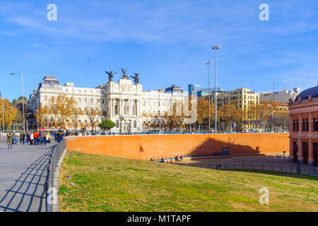 MADRID, SPAIN - JANUARY 1, 2018: View of the Agriculture ministry building, with locals and visitors, in Madrid, - Stock Photo