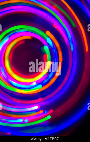 Neon circles, LED Lights Long Exposure, LED Lighting in blue, red, green, pink, cyan and magenta on nlack nackground - Stock Photo