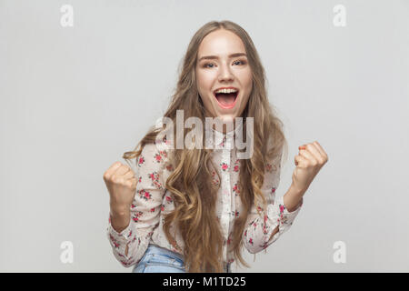 Win! Emotional blonde woman shout and have a happiness look and toothy smiling. Studio shot - Stock Photo