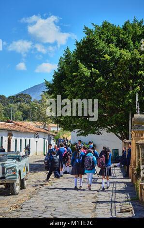 BOYACA, COLOMBIA - JANUARY 23, 2014: Students leaving the school in Villa de Leyva, Colombia. - Stock Photo
