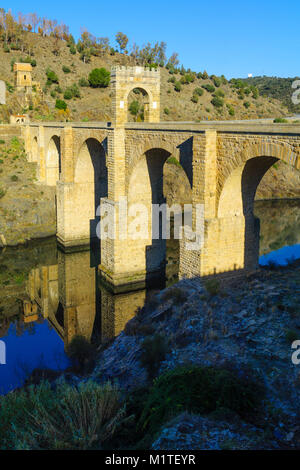 View of the Alcantara Bridge, a Roman stone arch bridge built over the Tagus River, in Extremadura, Spain - Stock Photo