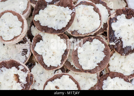 Preparing mushrooms for barbecue on holiday. Mushrooms with cheese spread in bowl. Cooking vegetables. Delicious - Stock Photo