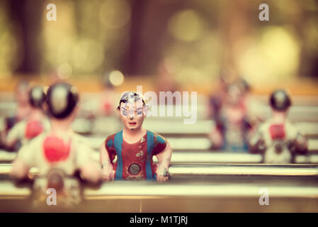 Foosball, old used table football, vintage style - Stock Photo