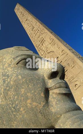 Egypt, Luxor. East Bank.Luxor temple. Statue of Ramses II and obelisk. - Stock Photo