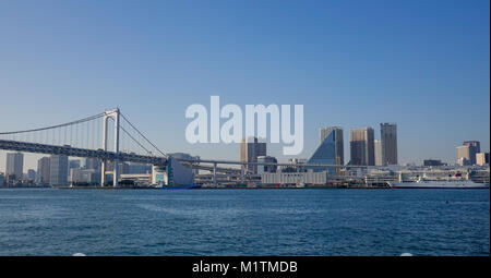 Tokyo, Japan - Jan 4, 2016. Cityscape of Tokyo Bay with Rainbow Bridge. The bay is inlet of the Pacific Ocean on - Stock Photo