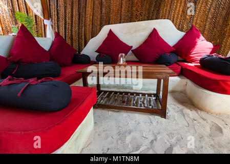 Beach cafe interior with wooden furniture - Stock Photo
