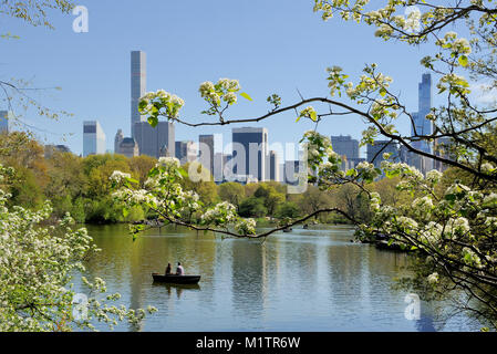 April 24, 2016 NEW YORK, USA-APRIL 24: Central Park in New York in summer time. Lake and small rowing boat. April - Stock Photo