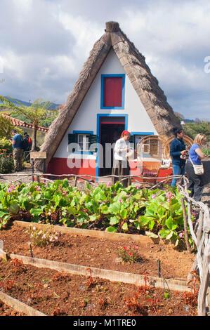 Traditional Palheiros dwellings, rebuilt as a tourist attraction, Santana, Madeira, Portugal - John Gollop - Stock Photo