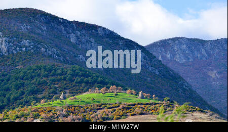 old traditional hay stacks, typical rural scene in albania - Stock Photo
