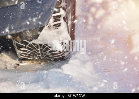 Winter tyre track on snow, winter tire concept, snowy day - Stock Photo
