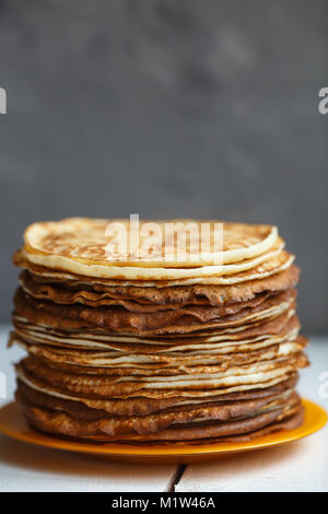 High stack of classic Russian thin pancakes. Rustic style. Traditional for the Russian pancake week Maslenitsa . - Stock Photo