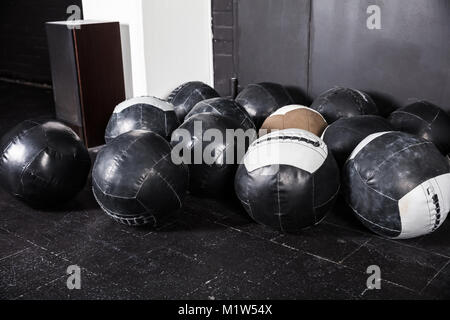 Medicine Balls Placed In An Empty Gym - Stock Photo