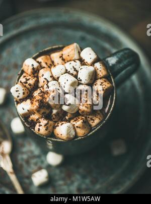 Winter warming hot chocolate with marshmallows in mug - Stock Photo
