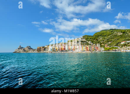 The colorful coastal city of Portovenere Italy with it's gothic churches and fortresses and lines of homes along - Stock Photo