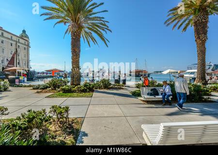 Sunny afternoon on the Riva Promenade at the Harbor of Split Croatia, on the Dalmatian Coast of the Adriatic Sea - Stock Photo