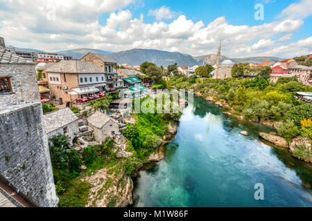 A view of Mostar Bosnia and Herzegovina with it's mosques, minarets and cafes lining the River Neretva from the - Stock Photo