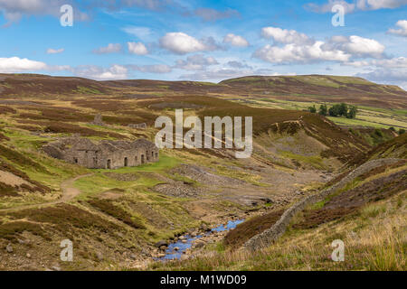 Yorkshire Dales landscape with the ruins of the Surrender Smelt Mill, between Feetham and Langthwaite, North Yorkshire, - Stock Photo
