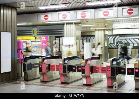 Passengers are going to the platform. Entrance to the railway station through the turnstile, Tokyo, Japan. Transport - Stock Photo