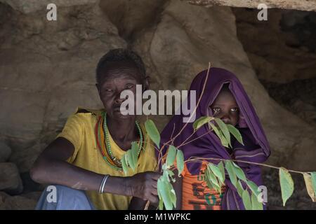 Karamoja, Uganda. 31st Jan, 2018. Former cutter Chepureto Lebul and a young girl from the Pokot tribe take part - Stock Photo