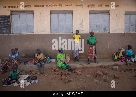 Karamoja, Uganda. 31st Jan, 2018. Women and girls sit outside Katabok Primary School. Credit: Sally Hayden/SOPA/ZUMA - Stock Photo