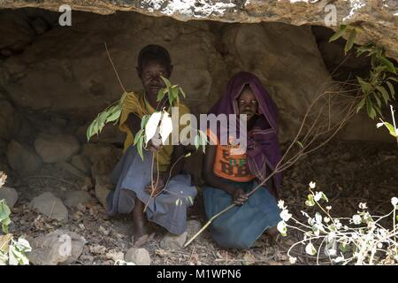 Karamoja, Uganda. 31st Jan, 2018. Chepureto Lebul, a former ''cutter'', and a young girl from the Pokot tribe part - Stock Photo