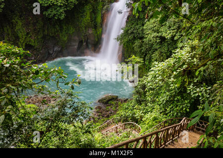 Majestic waterfall in the rainforest jungle of Costa Rica. Tropical hike. - Stock Photo