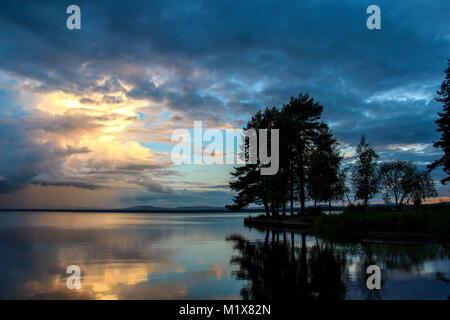 Sunset by Orsa Lake in Dalarna, Sweden. - Stock Photo