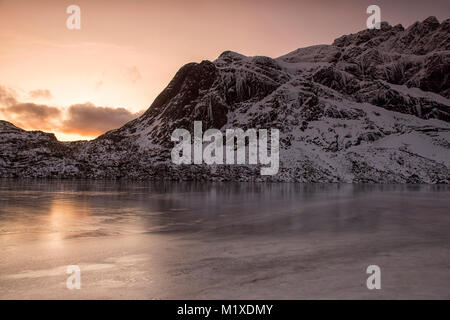 Snow covered mountains on the road to Nusfjord, Flakstadøya  Lofoten Islands Norway - Stock Photo