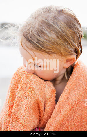 Girl wrapped in towel at Bohuslan, Sweden - Stock Photo