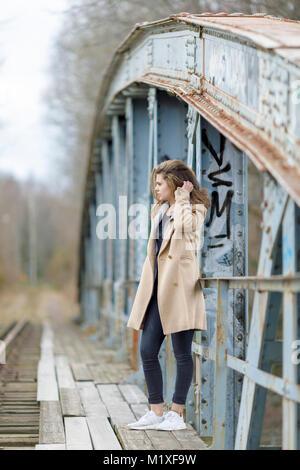 Teenage girl on bridge in Mjolby, Sweden - Stock Photo