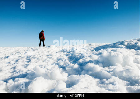 Man on snow in Biludden, Sweden - Stock Photo