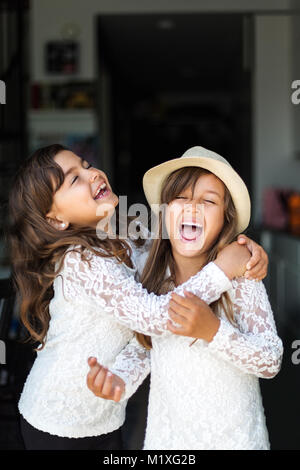 Two girls laughing in Sweden - Stock Photo