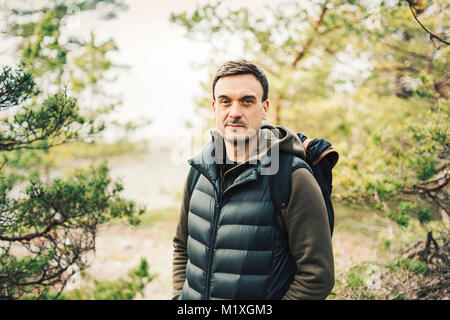 Portrait of mid adult man in Stockholm, Sweden - Stock Photo