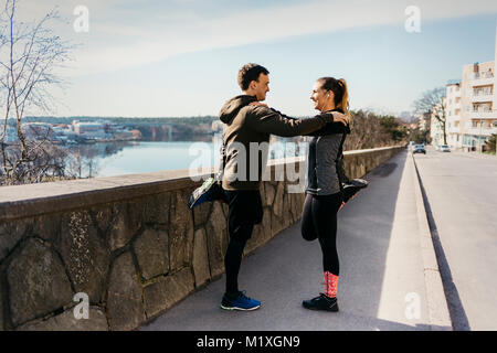 Couple stretching in Stockholm, Sweden - Stock Photo