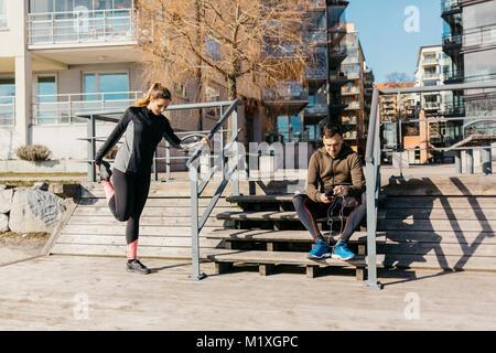 Couple preparing for run in Stockholm, Sweden - Stock Photo