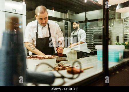 Chefs in kitchen - Stock Photo