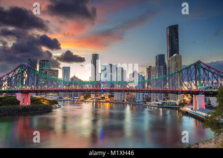 Brisbane. Cityscape image of Brisbane skyline, Australia with Story Bridge during dramatic sunset. - Stock Photo
