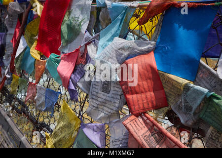 Bhutanese prayer flags tied to bridge in Bhutan - Stock Photo