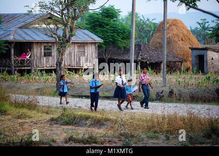 Children going to school in village of Kalyanpur, Nepal - Stock Photo